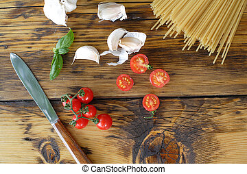 Spaghetti, cherry tomatoes and garlic. Cooking dinner