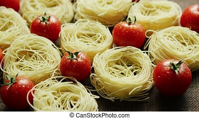 Spaghetti in rolls with fresh tomatoes - From above view of...