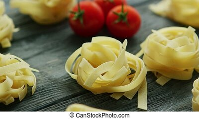 Spaghetti in shape of balls with tomatoes - Tagliatelle...