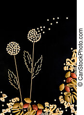 spaghetti in the form of dandelions on a dark background