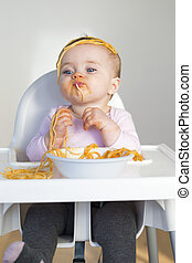Spaghetti Mess - Little Girl Eating her dinner and making a...