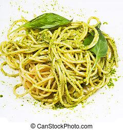 spaghetti mixed with pesto and basil leaf
