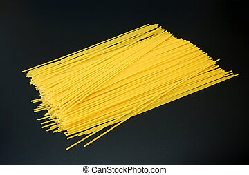 Spaghetti on dark gray background close up