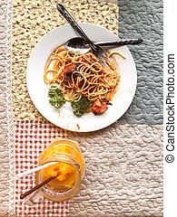 Spaghetti orange smoothie in jar