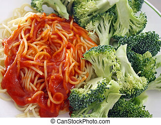 Spaghetti pasta with a homemade meatless tomato sauce. Fresh organic broccoli on the side