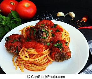 Spaghetti pasta with meatballs and tomato sauce