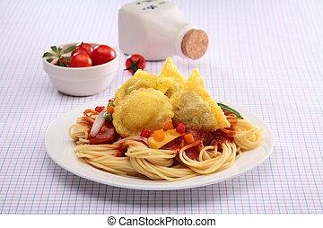 Spaghetti Ravioli with fried wonton and tomato on white plate
