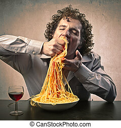 spaghetti - man eating spaghetti with his hands