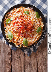 Spaghetti with Amatriciana Sauce on a plate. Vertical top ...