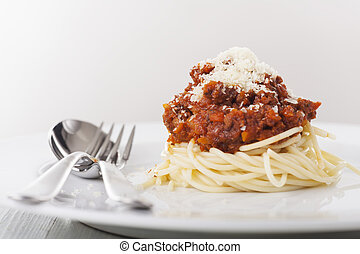 spaghetti with bolognes on a plate