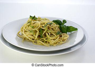 spaghetti with organic home made pesto on a plate