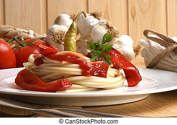 spaghetti with organic paprika on a plate