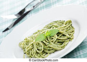 Spaghetti with pesto sauce and basil leaf