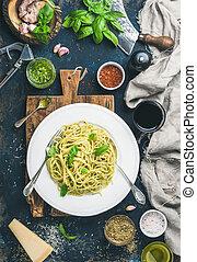 Spaghetti with pesto sauce, parmesan cheese, basil and wine