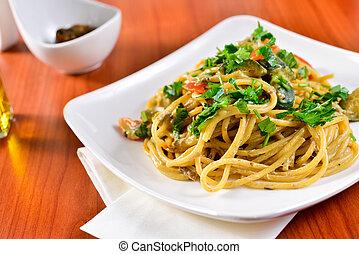 Plate of spaghetti with porcini mushrooms. Italian cuisine, Italian recipes