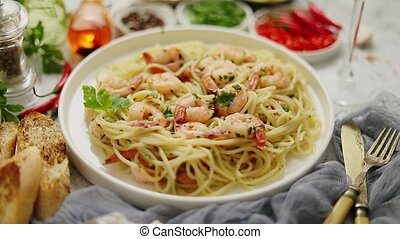 Spaghetti with shrimps on white ceramic plate and served ...