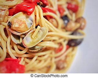 Spaghetti with tiny baby clams in the shell.