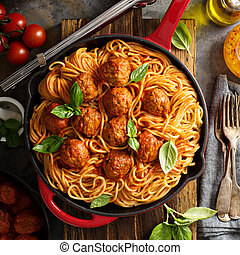 Spaghetti with tomato sauce and meatballs, fresh vegetable...