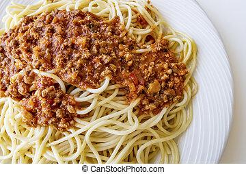 spaghetti with tomato sauce on white plate