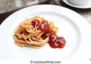 Spaghetti with tomato sauce on white dish.