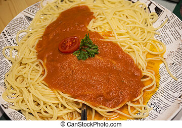 Spaghetti with tomato sauce with meat chopped on ceramic plate serve dinner in restaurant