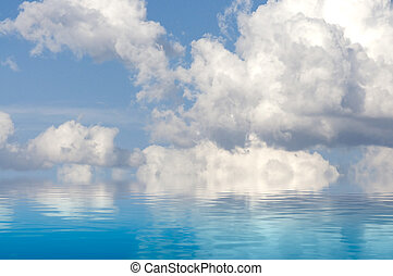 Spain. A sky of clouds reflected in a calm sea.