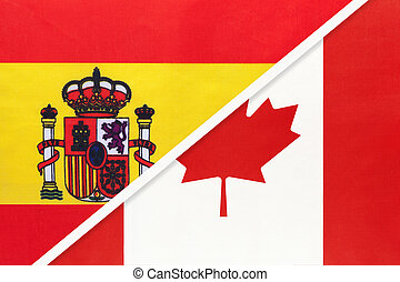 Spain and Canada, symbol of two national flags from textile. Partnership between European and American countries.