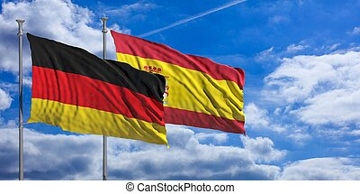 Spain and  Germany waving flags on blue sky. 3d illustration