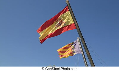 Spain and Valencia flags at the blue sky