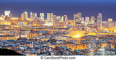 Spain, Cityscape of Barcelona at night.
