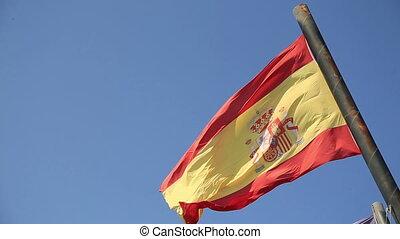 Spain  flag at the blue sky