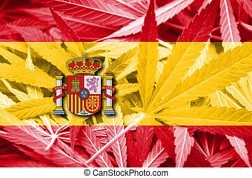 Spain Flag on cannabis background. Drug policy. Legalization...