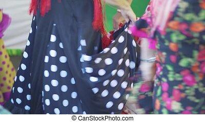 Spain - Flamenco. Women in traditional dresses dancing flamenko
