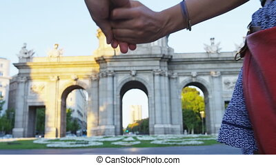 Spain - Madrid Tourists couple sightseeing walking by Puerta...