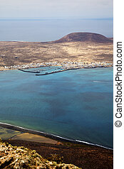 spain miramar del rock sky beach  boat   in lanzarote  graciosa