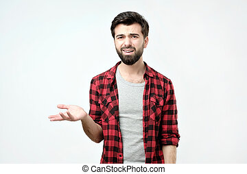 Spanish angry and discontented man spreading his hand and ask what do you mean