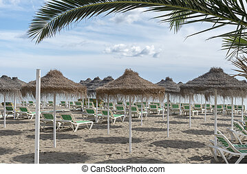 Spanish beach with loungers
