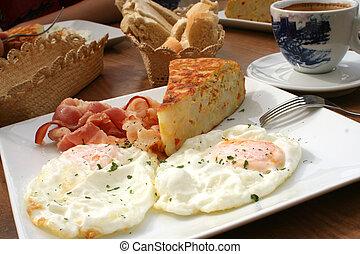 spanish breakfast - spanish omelet, bacon and eggs over easy