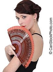 Spanish dancer holding a fan