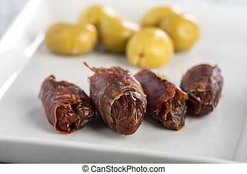 spanish dates with ham on a plate