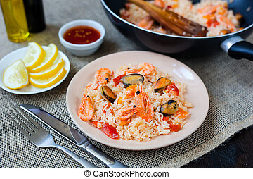 Spanish dish paella with seafood, shrimps in traditional pan