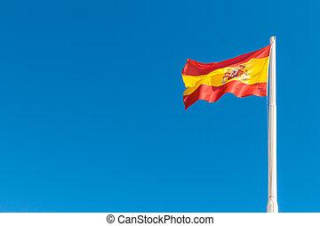 Spanish flag in the blue sky