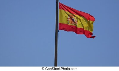 Spanish Flag Waving On Flagpole