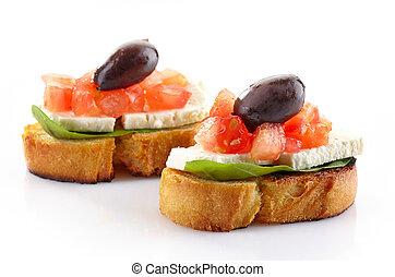Spanish food tapas, Toast with basil, tomato, fresh cheese...