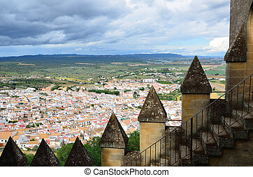 Spanish landscape with the white town and ancient battlements
