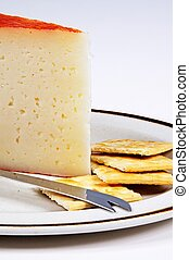 Spanish Manchego cheese. - Manchego cheese with crackers,...