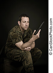 Spanish military with gun on black background
