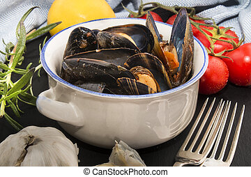 spanish mussels in a bowl with chorizo