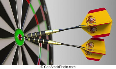 Spanish national achievement. Flags of Spain on darts hitting bullseye. Conceptual 3D animation