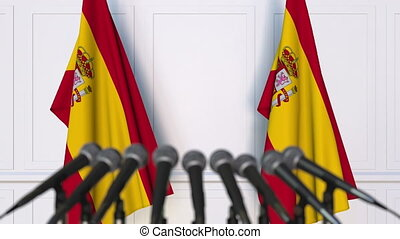 Spanish official press conference. Flags of Spain and...